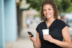 Happy Woman With Coffee Cup Using Smartphone Royalty Free Stock Photo