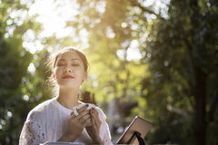 Happy woman and coffee in garden. Happy woman in garden in morning Royalty Free Stock Photos