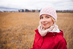 Happy Woman on a cold Autumn day. Happy Young Woman Portrait during cold Autumn day In a Field stock photo