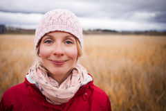 Happy Woman on a cold Autumn day. Happy Young Woman Portrait during cold Autumn day In a Field royalty free stock images