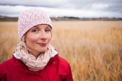 Happy Woman on a cold Autumn day. Happy Young Woman Portrait during cold Autumn day In a Field royalty free stock photography