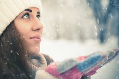 Happy woman at cold snowy winter at New York Park royalty free stock image