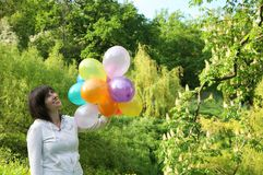 Happy woman with color balloons Royalty Free Stock Photos