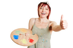 Woman with mixing palette holding Stock Photos