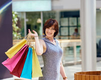 Happy Woman With colored Shopping Bags Royalty Free Stock Photos