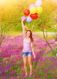 Happy woman with colorful balloons Royalty Free Stock Photography
