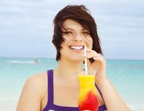 Happy woman with colorful cocktail Royalty Free Stock Image