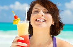 Happy woman with colorful cocktail Royalty Free Stock Photography