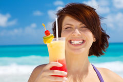 Happy woman with colorful cocktail Stock Photography