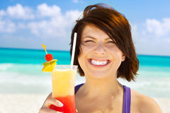 Happy woman with colorful cocktail Stock Photos