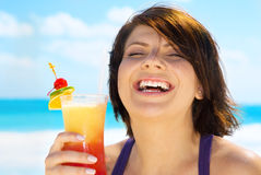 Happy woman with colorful cocktail Stock Images
