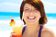 Happy woman with colorful cocktail Royalty Free Stock Photos