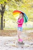Happy woman with colorful umbrella in autumn park Royalty Free Stock Image