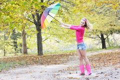 Happy woman with colorful umbrella in autumn park Royalty Free Stock Photography