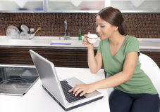 Happy woman with a computer Stock Photo