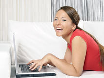 Happy woman with a computer Stock Images
