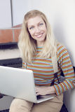 Happy woman with computer Royalty Free Stock Photography