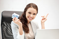 Happy woman with computer and euro cash money Stock Image