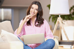 Happy woman with computer Stock Images