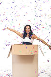 Happy woman with confetti out of the box stock photo