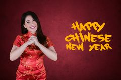Happy woman stands with text of Chinese new year royalty free stock photography
