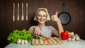 Happy woman cook. Smile woman cook gesturing thumbs up Stock Images