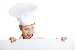 Happy woman cook or baker holding sign billboard. Royalty Free Stock Photo