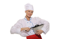 Happy woman-cook with pan and spoon Royalty Free Stock Images
