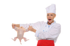 Happy woman-cook raw chicken Royalty Free Stock Photo