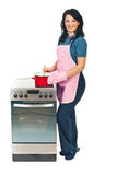 Happy woman cooking stock images