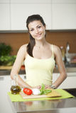 Happy woman cooking Royalty Free Stock Images