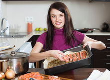 Happy woman cooking fish pie with salmon Royalty Free Stock Photography