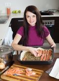 Happy woman cooking fish pie with salmon Royalty Free Stock Image