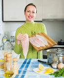 Happy woman cooking fish soup Stock Photography