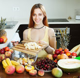 Happy woman cooking fruit salad Royalty Free Stock Photo