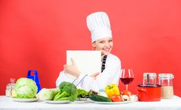 Happy woman cooking healthy food by recipe. cafe menu. Dieting. woman in cook hat. professional chef on red background. Organic eating and vegetarian royalty free stock images