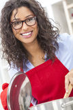 Happy Woman Cooking in Kitchen Royalty Free Stock Image
