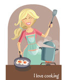 Happy woman cooking lunch Stock Image