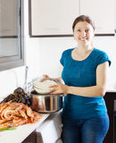 Happy woman cooking paella Royalty Free Stock Images