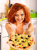 Happy woman cooking pizza. Stock Image