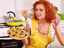 Happy woman cooking pizza Stock Images