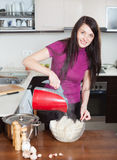 Happy woman cooking rice noodles Royalty Free Stock Photography