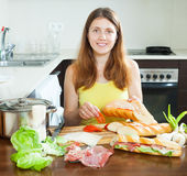 Happy woman cooking spanish sandwiches Stock Photo