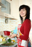 Happy woman cooking vegetables Royalty Free Stock Photos