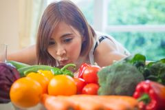 Happy woman cooking vegetables green salad Royalty Free Stock Images