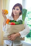 Happy woman cooking vegetables green salad Stock Photography