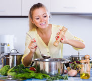 Happy woman cooking veggie food Royalty Free Stock Photo