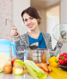 Happy  woman cooking veggie soup Stock Images