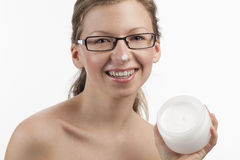 Happy woman with cosmetic product Royalty Free Stock Photography