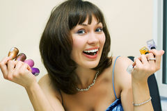 Happy woman with cosmetics. Stock Image